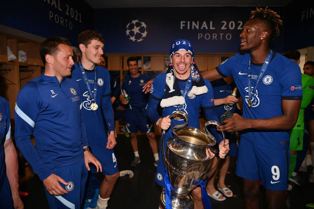 Mason Mount and Tammy Abraham of Chelsea celebrate inside the dressing room with the Champions League Trophy following their team's victory during...