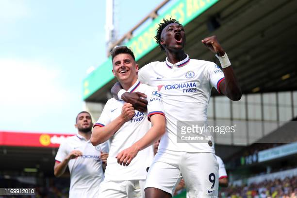 Mason Mount and Tammy Abraham of Chelsea celebrates after scoring their team's second goal during the Premier League match between Norwich City and...