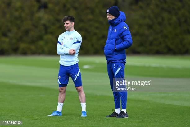 Mason Mount and Thomas Tuchel of Chelsea during a training session at Chelsea Training Ground on April 16, 2021 in Cobham, England.