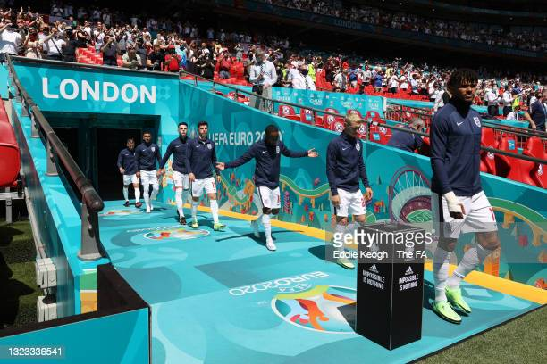 Mason Mount, Jack Grealish, Phil Foden and Tyrone Mings of England enter the pitch prior to the UEFA Euro 2020 Championship Group D match between...