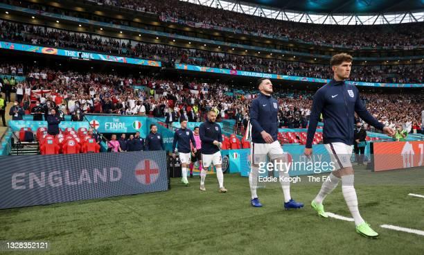 Mason Mount, Luke Shaw, Declan Rice and John Stones of England make their way towards the pitch prior to the UEFA Euro 2020 Championship Final...