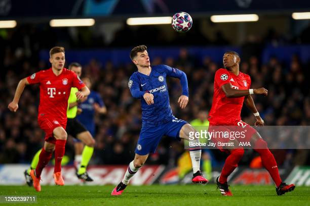 Mason Mount of Chelsea and David Alaba of Bayern Munich during the UEFA Champions League round of 16 first leg match between Chelsea FC and FC Bayern...