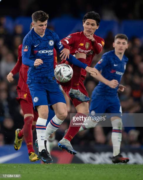 Mason Mount of Chelsea and Takumi Minamino of Liverpool during the FA Cup Fifth Round match between Chelsea FC and Liverpool FC at Stamford Bridge on...