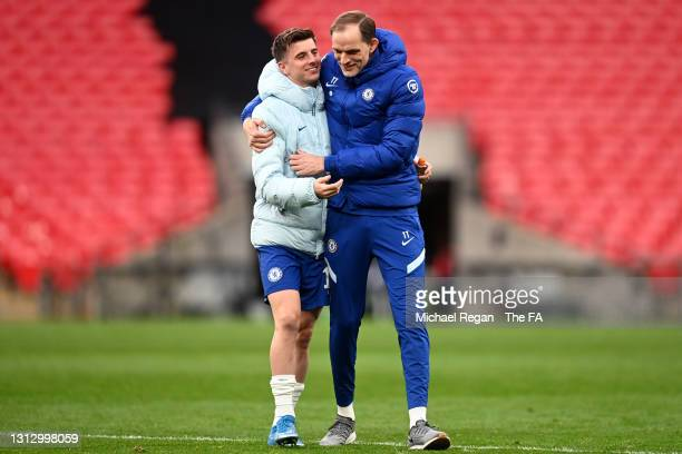 Mason Mount of Chelsea and Thomas Tuchel, Manager of Chelsea celebrate following their team's victory in the Semi Final of the Emirates FA Cup match...