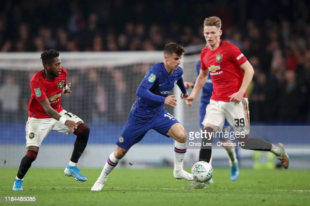 Mason Mount of Chelsea attempts to get away from Fred of Manchester United during the Carabao Cup Round of 16 match between Chelsea and Manchester...