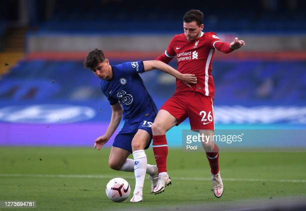 Mason Mount of Chelsea battles for possession with Andy Robertson of Liverpool during the Premier League match between Chelsea and Liverpool at...