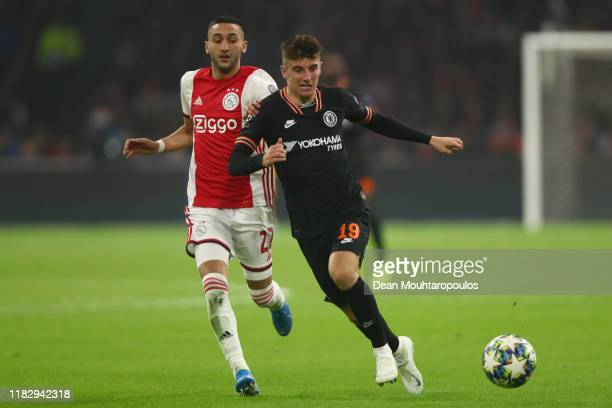 Mason Mount of Chelsea battles for possession with Hakim Ziyech of AFC Ajax during the UEFA Champions League group H match between AFC Ajax and...