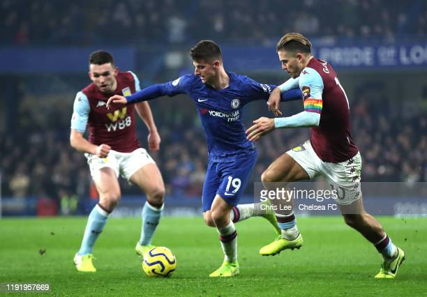 Mason Mount of Chelsea battles for possession with Jack Grealish of Aston Villa during the Premier League match between Chelsea FC and Aston Villa at...