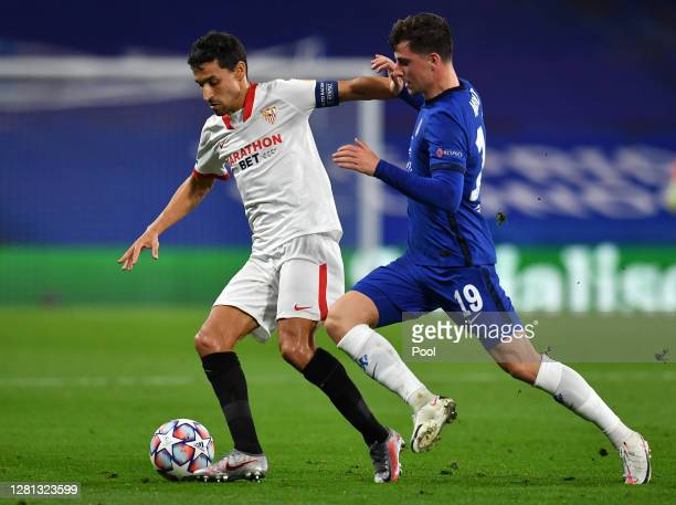 Mason Mount of Chelsea battles for possession with Jesus Navas of Sevilla during the UEFA Champions League Group E stage match between Chelsea FC and...
