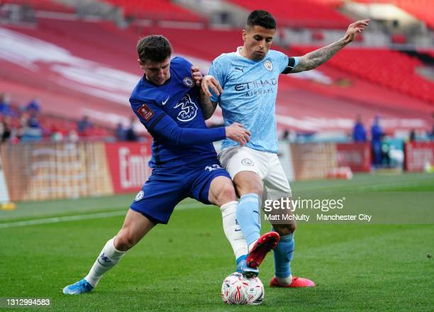 Mason Mount of Chelsea battles for possession with Joao Cancelo of Manchester City during the Semi Final of the Emirates FA Cup match between...