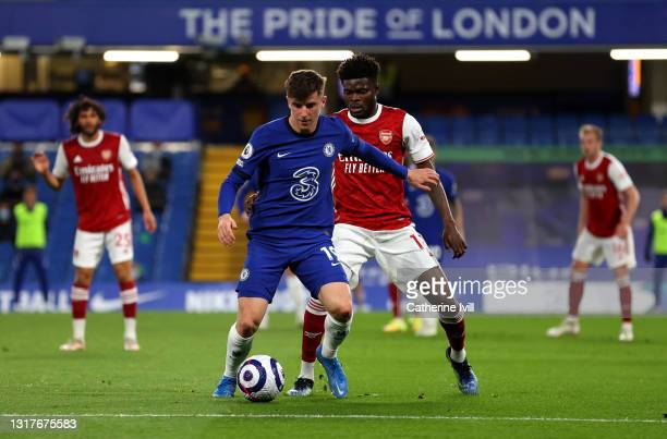 Mason Mount of Chelsea battles for possession with Thomas Partey of Arsenal during the Premier League match between Chelsea and Arsenal at Stamford...