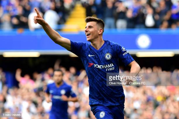 Mason Mount of Chelsea celebrates after scoring his team's first goal during the Premier League match between Chelsea FC and Leicester City at...
