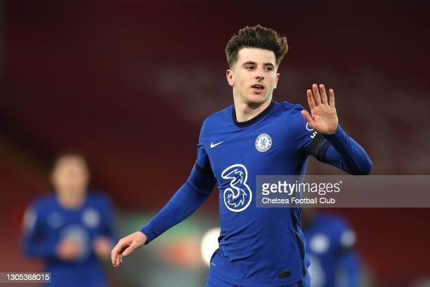 Mason Mount of Chelsea celebrates after scoring his team's first goal during the Premier League match between Liverpool and Chelsea at Anfield on...