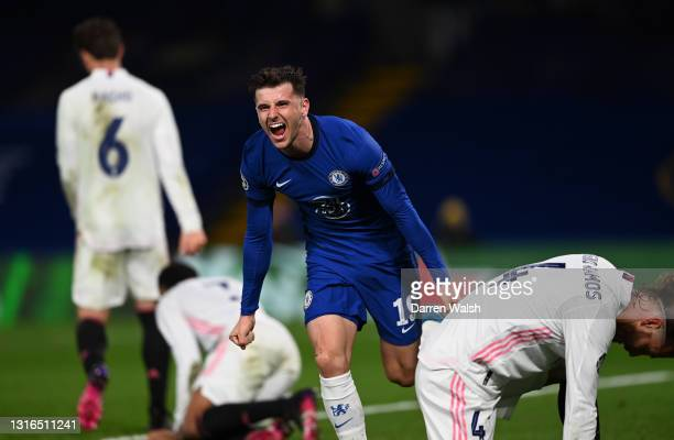 Mason Mount of Chelsea celebrates after scoring his team's second goal as Sergio Ramos of Real Madrid looks dejected during the UEFA Champions League...
