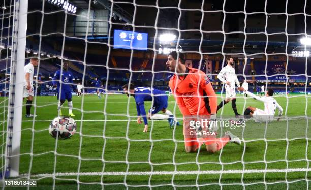 Mason Mount of Chelsea celebrates after scoring their team's second goal as Thibaut Courtois of Real Madrid looks dejected during the UEFA Champions...