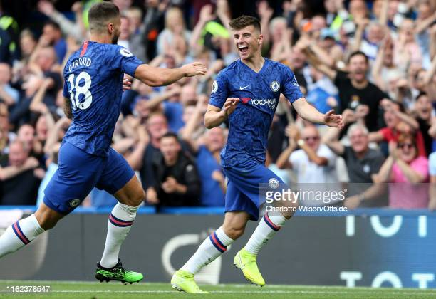 Mason Mount of Chelsea celebrates scoring the opening goal during the Premier League match between Chelsea FC and Leicester City at Stamford Bridge...