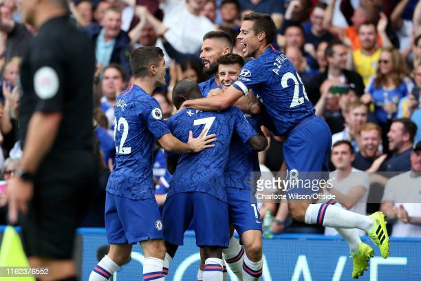 Mason Mount of Chelsea celebrates scoring the opening goal with his team mates during the Premier League match between Chelsea FC and Leicester City...