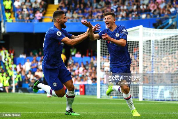 Mason Mount of Chelsea celebrates scoring the opening goal with teammate Olivier Giroud during the Premier League match between Chelsea FC and...