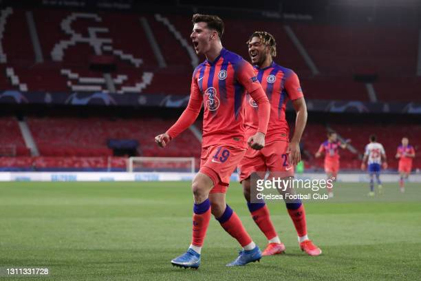 Mason Mount of Chelsea celebrates with team mate Reece James after scoring their side's first goal during the UEFA Champions League Quarter Final...