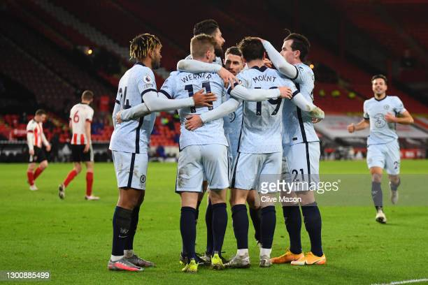 Mason Mount of Chelsea celebrates with team mates after scoring their side's first goal during the Premier League match between Sheffield United and...