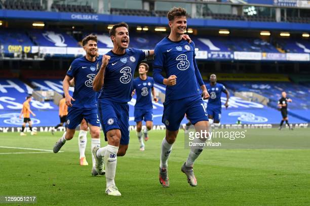 Mason Mount of Chelsea celebrates with teammate Cesar Azpilicueta after scoring his team's first goal during the Premier League match between Chelsea...