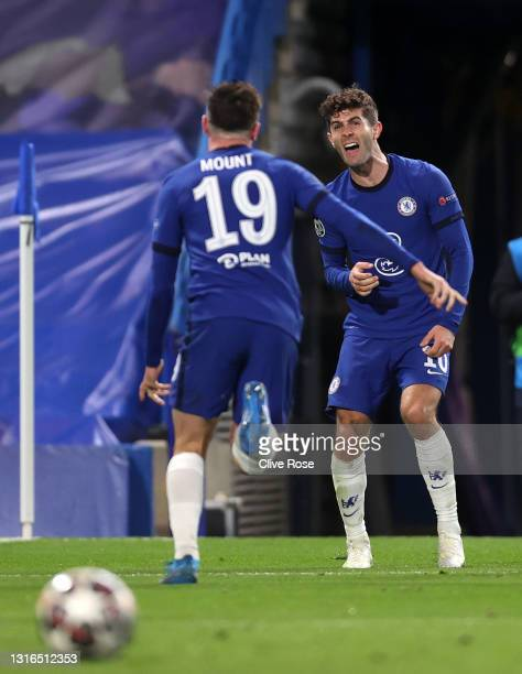 Mason Mount of Chelsea celebrates with teammate Christian Pulisic after scoring their team's second goal during the UEFA Champions League Semi Final...
