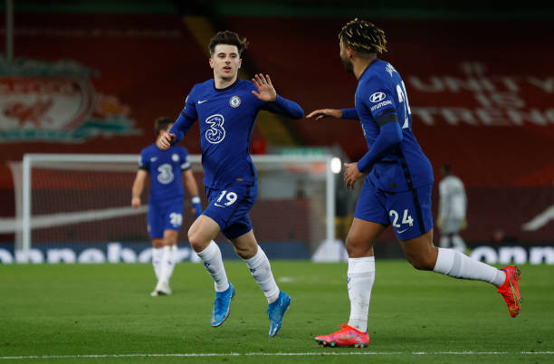 Mason Mount of Chelsea celebrates with teammate Reece James after scoring his team's first goal during the Premier League match between Liverpool and...