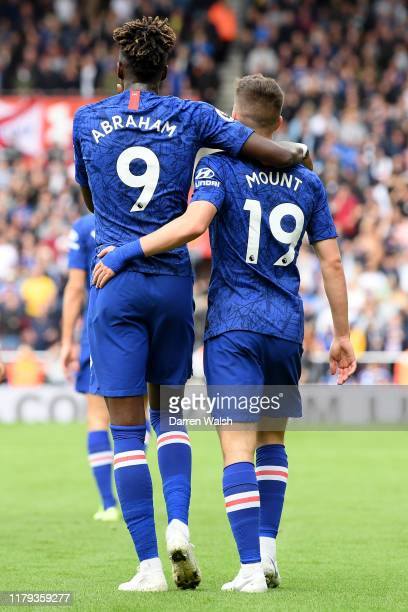 Mason Mount of Chelsea celebrates with teammate Tammy Abraham after scoring his teams second goal during the Premier League match between Southampton...