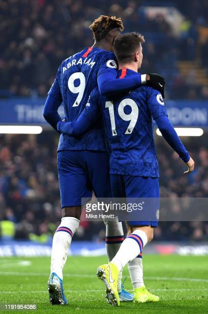 Mason Mount of Chelsea celebrates with teammate Tammy Abraham after scoring his team's second goal during the Premier League match between Chelsea FC...
