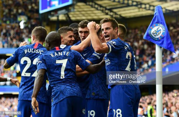 Mason Mount of Chelsea celebrates with teammates after scoring his team's first goal during the Premier League match between Chelsea FC and Leicester...