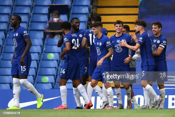 Mason Mount of Chelsea celebrates with teammates after scoring his team's first goal during the Premier League match between Chelsea FC and...