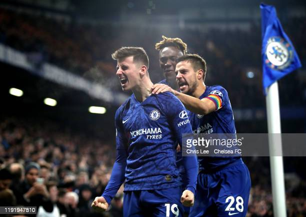 Mason Mount of Chelsea celebrates with teammates Cesar Azpilicueta and Tammy Abraham after scoring his team's second goal during the Premier League...