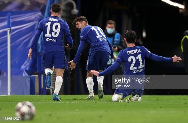 Mason Mount of Chelsea celebrates with teammates Christian Pulisic and Ben Chilwell after scoring their team's second goal during the UEFA Champions...