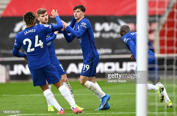 Mason Mount of Chelsea celebrates with teammates Reece James and Timo Werner after scoring his team's first goal during the Premier League match...