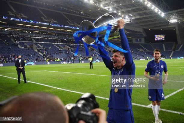 Mason Mount of Chelsea celebrates with the Champions League Trophy following their team's victory in the UEFA Champions League Final between...