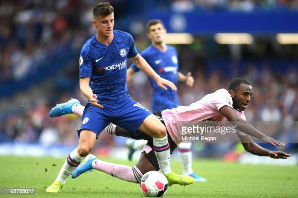 Mason Mount of Chelsea challenges for the ball with Ricardo Pereira of Leicester City during the Premier League match between Chelsea FC and...
