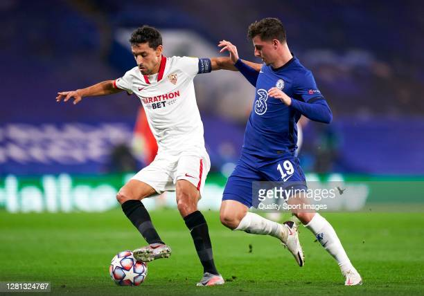 Mason Mount of Chelsea competes for the ball with Jesus Navas of Sevilla during the UEFA Champions League Group E stage match between Chelsea FC and...