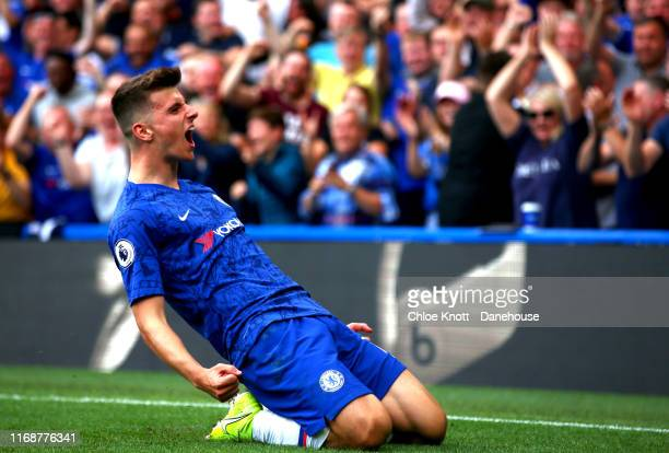 Mason Mount of Chelsea FC celebrates scoring his teams first goal during the Premier League match between Chelsea FC and Leicester City at Stamford...