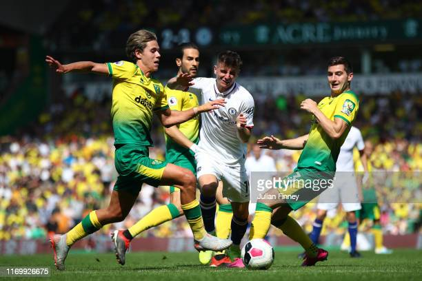 Mason Mount of Chelsea fights through players of Norwich City during the Premier League match between Norwich City and Chelsea FC at Carrow Road on...