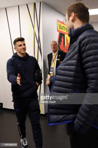 Mason Mount of Chelsea high fives Petr Cech as he arrives at the stadium prior to the Premier League match between Watford FC and Chelsea FC at...