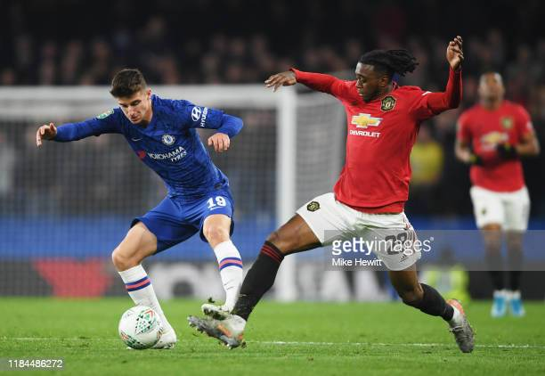 Mason Mount of Chelsea is challenged by Aaron WanBissaka of Manchester United during the Carabao Cup Round of 16 match between Chelsea and Manchester...