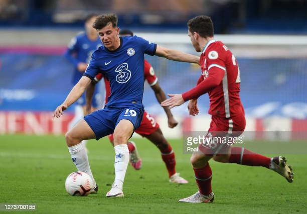 Mason Mount of Chelsea is challenged by Andy Robertson of Liverpool during the Premier League match between Chelsea and Liverpool at Stamford Bridge...