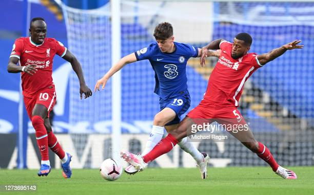 Mason Mount of Chelsea is challenged by Georginio Wijnaldum of Liverpool during the Premier League match between Chelsea and Liverpool at Stamford...