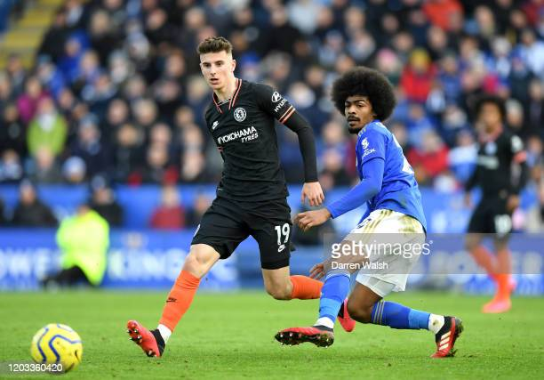 Mason Mount of Chelsea is challenged by Hamza Choudhury of Leicester City during the Premier League match between Leicester City and Chelsea FC at...
