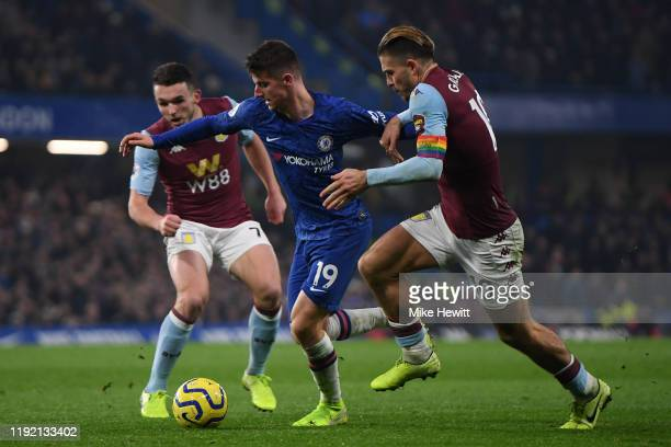 Mason Mount of Chelsea is challenged by Jack Grealish of Aston Villa during the Premier League match between Chelsea FC and Aston Villa at Stamford...