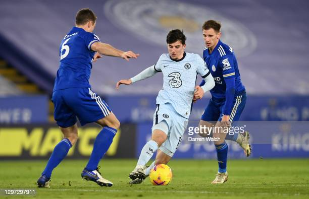 Mason Mount of Chelsea is challenged by Jonny Evans and Marc Albrighton of Leicester City during the Premier League match between Leicester City and...