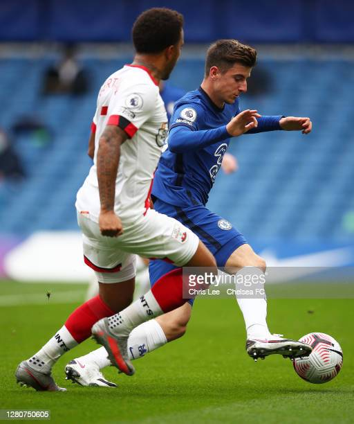 Mason Mount of Chelsea is challenged by Maya Yoshida of Southampton during the Premier League match between Chelsea and Southampton at Stamford...