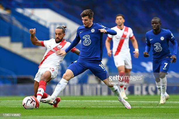 Mason Mount of Chelsea is challenged by Theo Walcott of Southampton during the Premier League match between Chelsea and Southampton at Stamford...