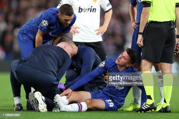 Mason Mount of Chelsea is treated for an ankle injury during the UEFA Champions League group H match between Chelsea FC and Valencia CF at Stamford...
