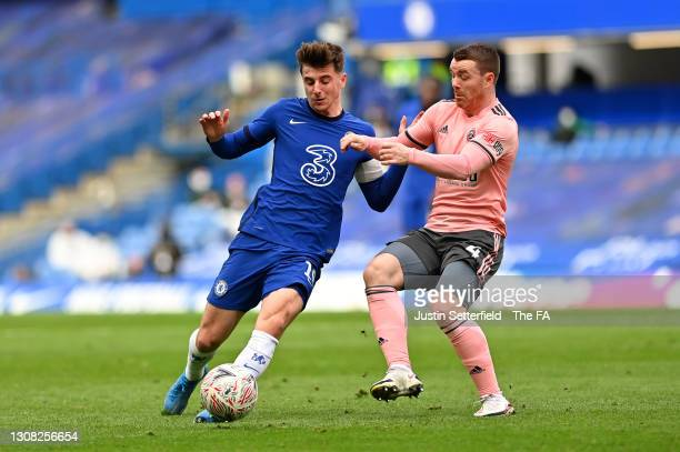 Mason Mount of Chelsea looks to break past John Fleck of Sheffield United during the Emirates FA Cup Quarter Final match between Chelsea FC and...